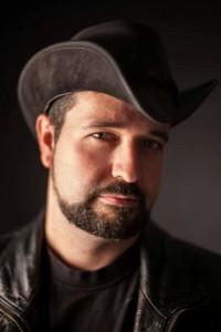 Chris, author portrait in hat